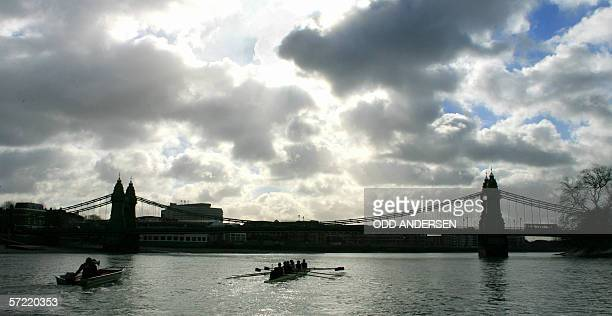 The Oxford rowing team and their coaching vessel approach Hammersmith bridge 31 March 2006 during a practice on the river Thames in west London two...