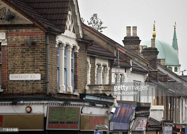 The Queens road Mosque is seen amongst some shops 14 August 2006 in Walthamsow near one of the addresses that London Metropolitan Police officers...