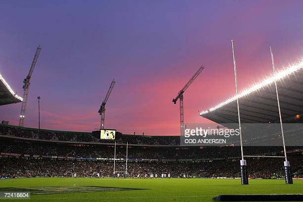The sun sets over the newly opened south stand of the Twickenham stadium as England plays New Zealand in an international rugby union test match in...