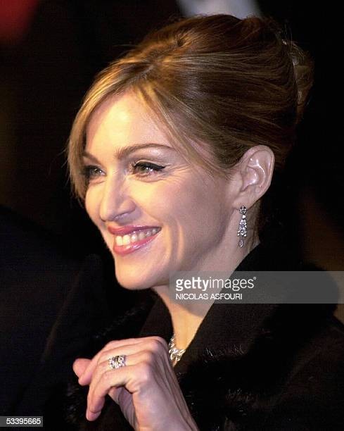 This 18 November 2002 file photo shows US singer and actress Madonna arriving at the World film premiere of 'Die Another Day' the new James Bond film...