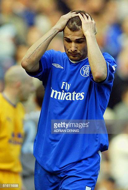 This file photo shows Chelsea's Adrian Mutu holding his head after missing a shot against Everton during the Premiership football match at Stamford...