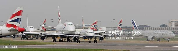 London, UNITED KINGDOM: This file picture dated 03 June 2004 shows planes queuing up for take off at London's Heathrow airport. An alleged terror...