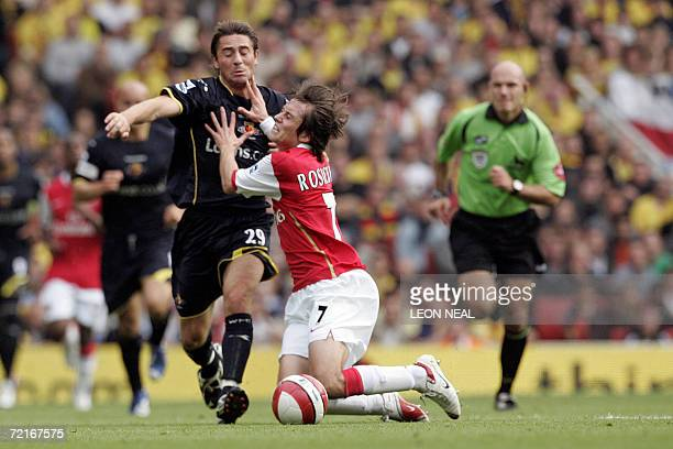London, UNITED KINGDOM: Tommy Smith of Watford fights for the ball against Tomas Rosicky of Arsenal in a Barclays Premier League match at the...
