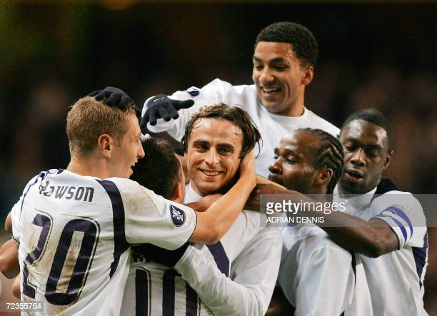 Tottenham Hotspur's Dimitar Berbatov celebrates with his team mates after scoring the equalising goal against Club Brugge during the UEFA Cup Group B...