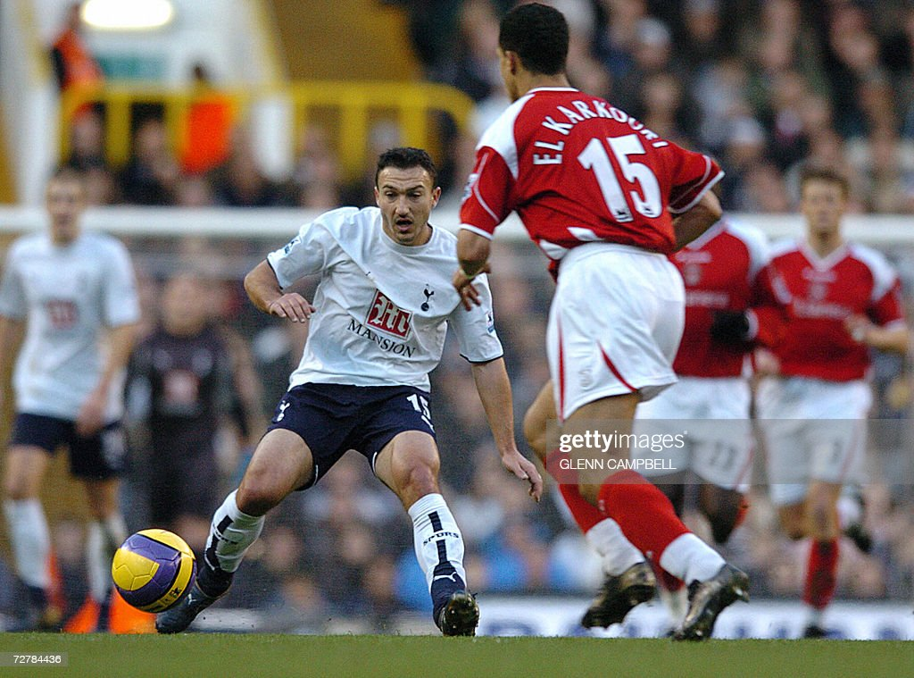 Tottenham Hotspur's French player Steed Malbranque (C) vies with Charlton's Moroccan Talal El Karkouri during their English Premiership match at White Hart Lane in north London, 09 December 2006. AFP PHOTO / GLENN CAMPBELL Mobile and website use of domestic English football pictures subject to subscription of a license with Football Association Premier League (FAPL) tel : +44 207 298 1656. For newspapers where the football content of the printed and electronic versions are identical, no licence is necessary.