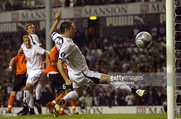 London, UNITED KINGDOM: Tottenham Hotspur's Robbie Keane misses an early chance on goal against Slavia Prague during the UEFA Cup first round second...