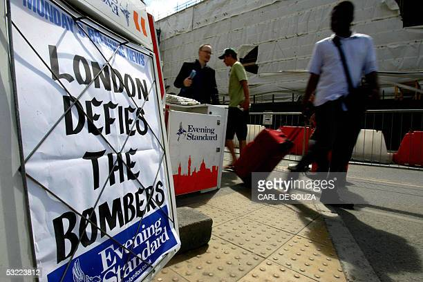 Train passengers pass a newspaper advertisement at Kings Cross train station in London 11 July 2005 Prime Minister Tony Blair said Today that Britain...