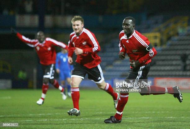 Trinidad and Tobago player Dwight Yorke turns to celebrate after he scored the opening goal against Iceland during the International friendly match...