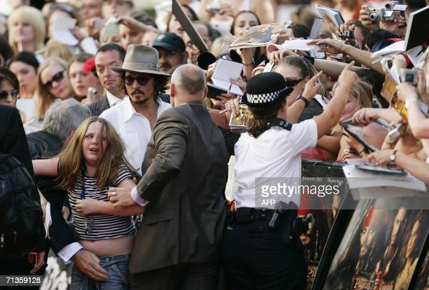 London, UNITED KINGDOM: US actor Johnny Depp arrives at Leicester Square Odeon cinema London for the UK premier of Pirates of the Caribbean 2, Dead...