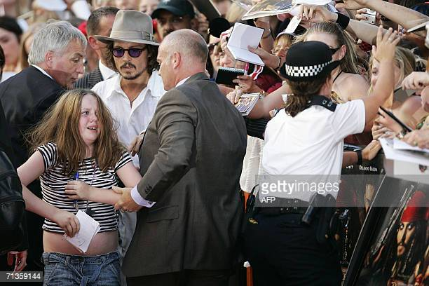 US actor Johnny Depp arrives at Leicester Square Odeon cinema London for the UK premier of Pirates of the Caribbean 2 Dead Man's Chest as a young...