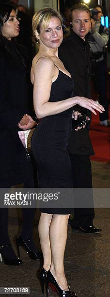 US actress Renee Zellweger makes a few dance steps as she arrives for the World Premiere of her latest film Miss Potter in London's Leicester Square...