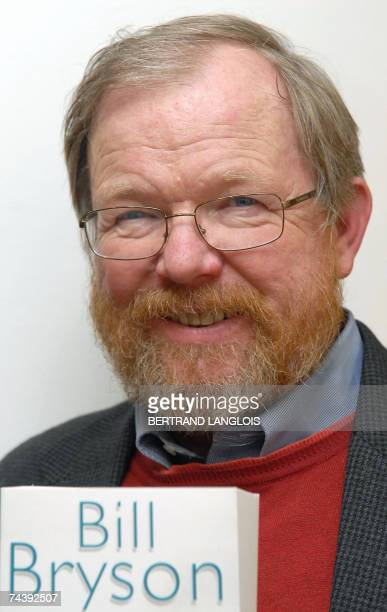 US author Bill Bryson poses with the paperback publication of his autobiography 'The Life and Times of the Thunderbolt Kid' at a book shop in London...