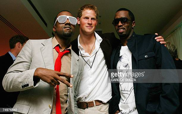 US rapper Kanye West poses with Prince Harry and US rapper P Diddy at Wembley Arena in north London 01 July 2007 as 60000 revellers join Princes...