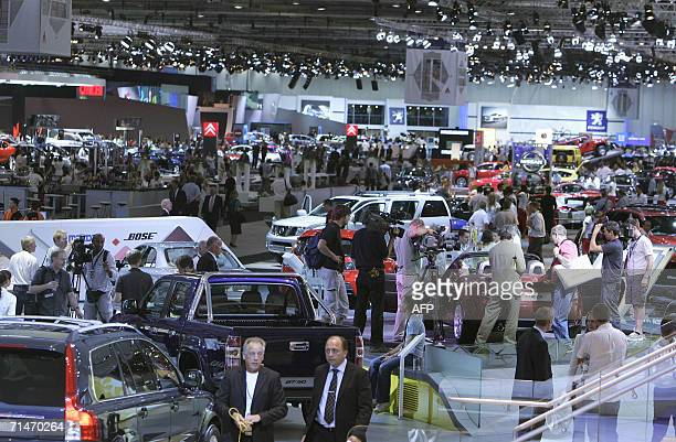 Visitors stroll 18 July 2006 at the UK Motor Show at London's Docklands Excel CentreAFP PHOTO/SHAUN CURRY
