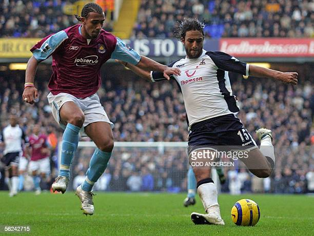 West Ham goal scorer Anton Ferdinand vies for the ball with Tottenham goal scorer Mido during a premiership match at White Hart Lane in northern...