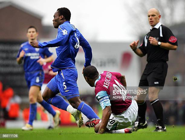 West Ham's Nigel ReoCoker slides in to tackle Mickael Essien of Chelsea during the Premiership football match at Upton Park in London 02 January 2006...