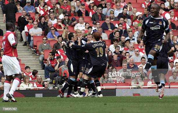 West Ham's striker Bobby Zamora celebrates with teammates after scoring at the end of the first half against Arsenal during their English Premiership...