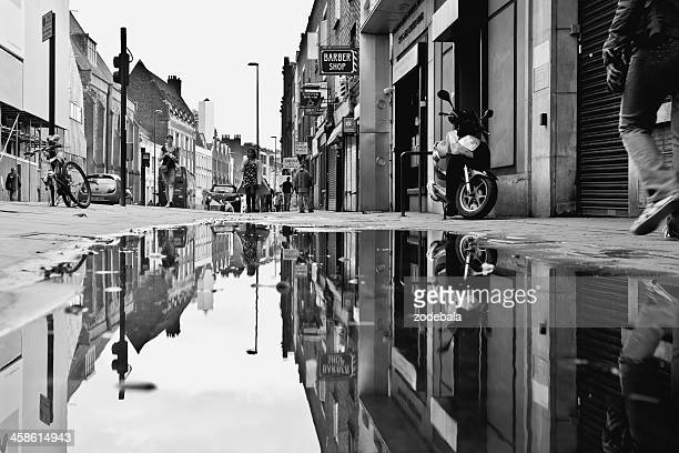 London Urban Scene, People Reflection on a Puddle