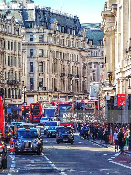 UK, London, Urban scene with double-Decker buses and taxis