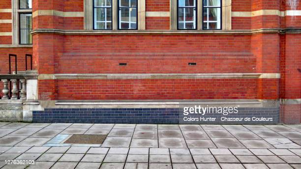 london victorian building facade in bricks, windows and sidewalk - street stock pictures, royalty-free photos & images