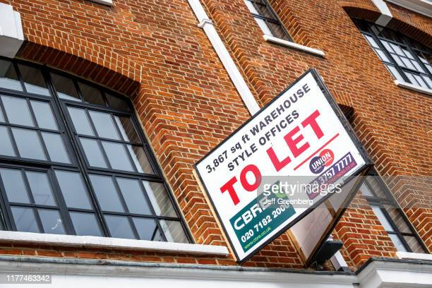London, warehouse style commercial real estate, to let sign.