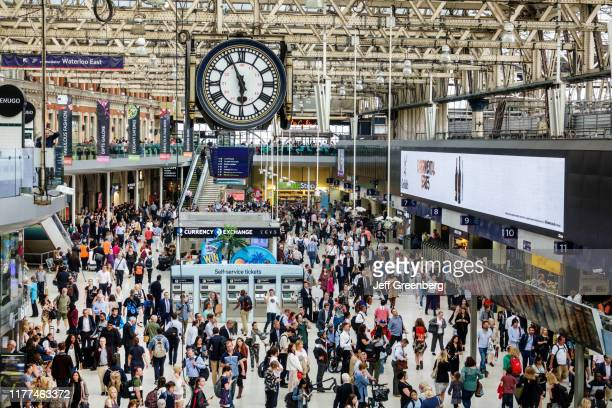 London Waterloo Station crowds of commuters and station clock