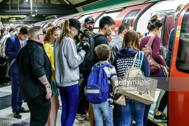 London Waterloo Underground Station passengers loading into crowded train