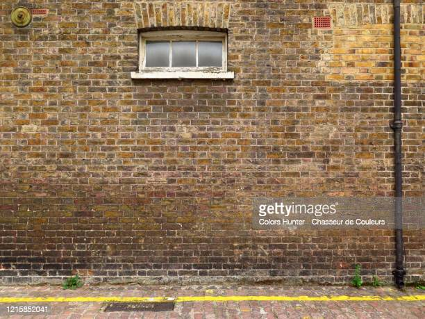 london weathered brick facade with window and gutter - wall building feature stock pictures, royalty-free photos & images