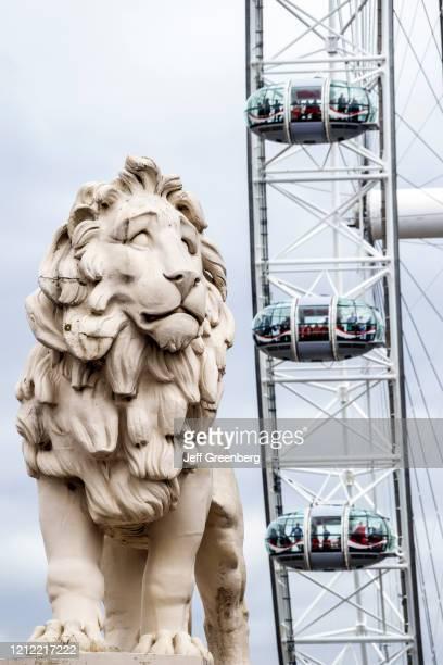 London, Westminster Bridge and London Eye, giant Ferris wheel.
