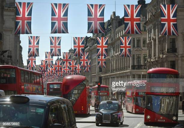 london with british flags - west end london stock photos and pictures