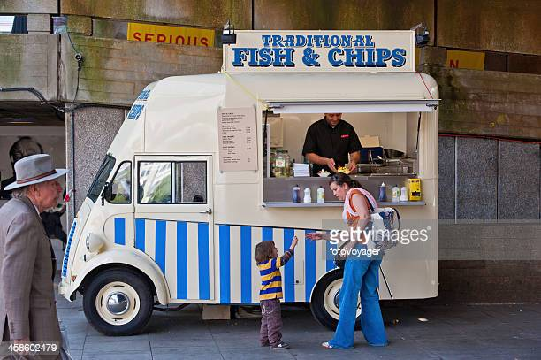 London woman buying fish and chips for child