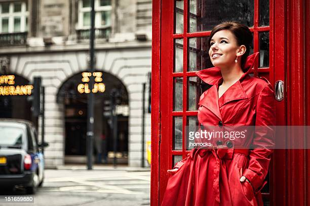 London Woman in Red Posing at Phone Booth
