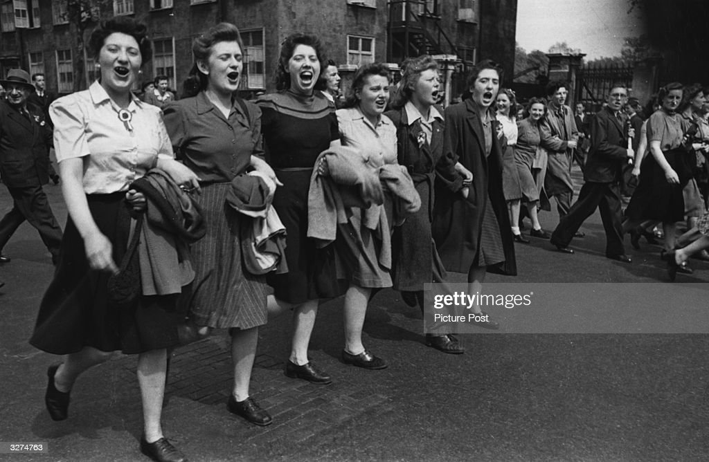 London women singing in the streets on VE Day. Original Publication: Picture Post - 1991 - This Was VE Day In London - pub. 19th May 1945