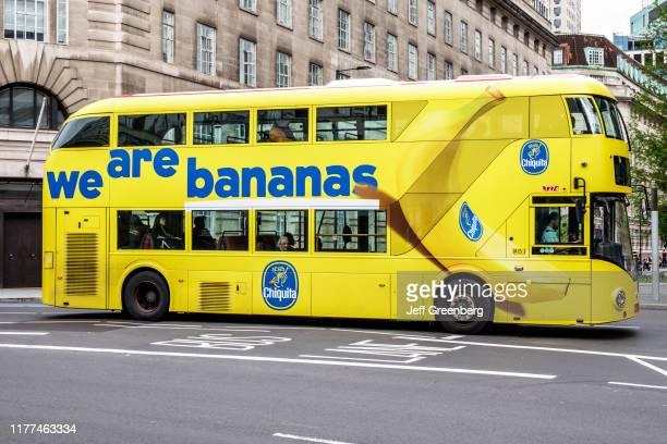 London, yellow double decker bus, Chiquita Bananas wrapped advertisement.