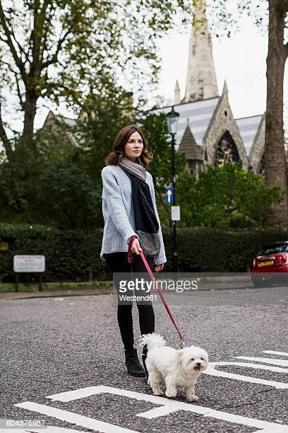 UK, London, young woman going walkies with her dog