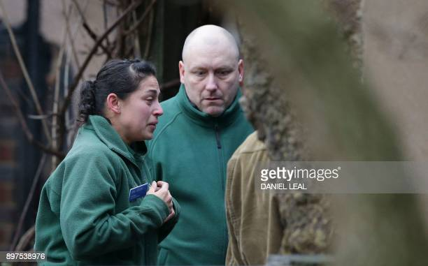 London Zoo employees comfort a colleague after a fire broke out at a cafe and shop at London Zoo in London on December 23 2017 A fire broke out at...