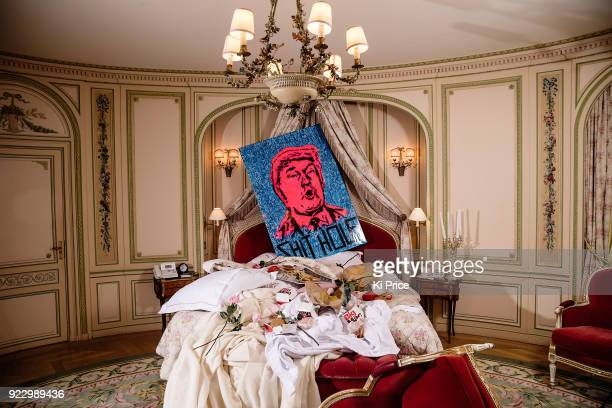 Londonbased artist Endless poses with his portrait of US President Donald Trump on February 21 2018 in London United Kingdom The artist incorporated...