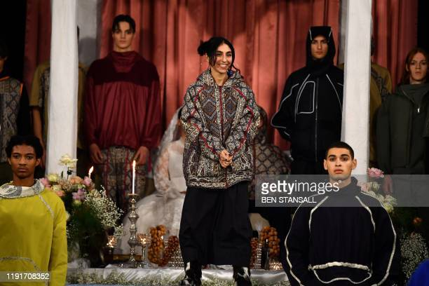 Londonbased designer Paria Farzaneh gestures from the catwalk after her show on the first day of the Autumn/Winter 2020 London Fashion Week Men's in...