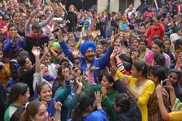 Londonbased Punjabi pop singer Malkit Singh performs during a promotional event at a college in Amritsar on February 8 2016 Malkit Singh visited the..