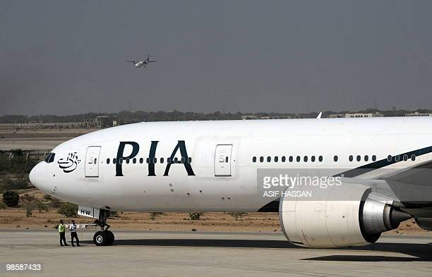A Londonbound staterun Pakistan International Airlines plane taxies before takeoff from Karachi International Airport in Karachi on April 21 2010 PIA...