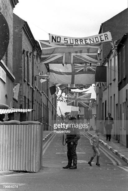 """Londonderry, Northern Ireland, 11th August 1971, Loyalist flags, Union Jacks and a """"No Surrender"""" flag bedeck Fountain Street in Londonderry as an..."""