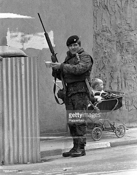 Londonderry Northern Ireland 12th August 1971 A British soldier enjoys a cup of tea whilst holding a gun on patrol in Londonderry