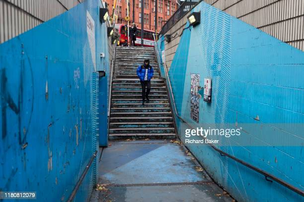 Londoner descends the underpass steps leading into the Old Street station in Shoreditch, on 4th November 2019, in London, England.