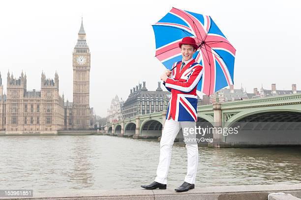 Londoner in Union Jack clothes with Houses of Parliament