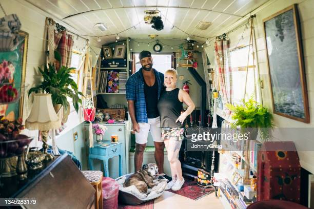 londoners and dog enjoying cozy lifestyle on canal boat - ambient light stock pictures, royalty-free photos & images