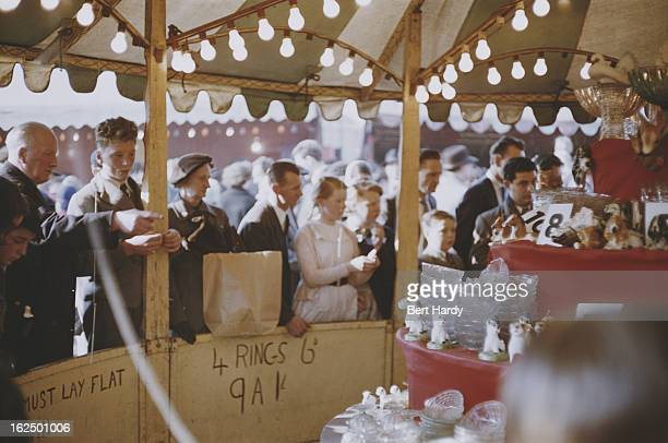 Londoners at a hoopla stall at an Easter Fair held on Hampstead Heath London 1956 Original publication Picture Post Easter Fair unpub