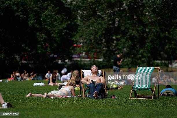 Londoners bask in the sunshine in Green Park as forecasters predict that it will be the hottest day of the year on June 13 2014 in London England The...
