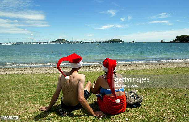 Londoners Dave Burbridge and Kathyrn Howe enjoy the Christmas fine weather at Auckland's Okahu Bay a change from the cold Chritmas weather back home...