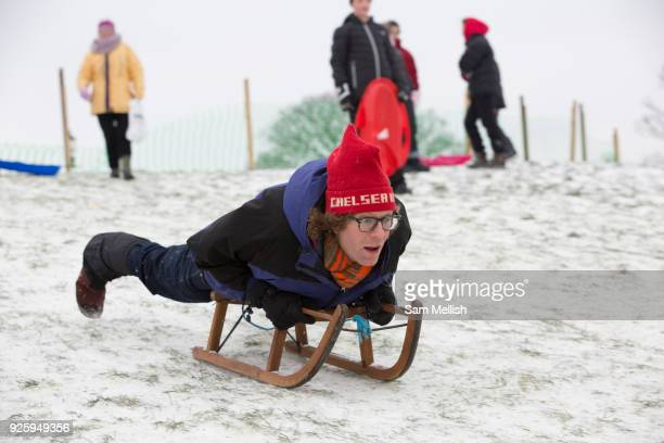 Londoners enjoy sledging at Primrose Hill following a second day of snow on the 1st March 2018 in North London United Kingdom A cold front from...