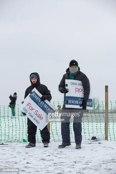 Londoners enjoy sledging on for sale signs at Primrose Hill following a second day of snow on the 1st March 2018 in North London United Kingdom A...